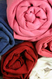 Rolled shirts. Rolled cotton t-shirts Stock Photography
