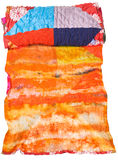 Rolled silk batik and patchwork scarf isolated Royalty Free Stock Photo