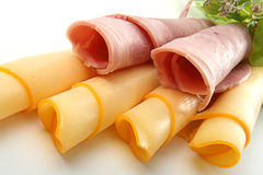 Rolled slice of ham with cheese. Isolated on white backgroud Royalty Free Stock Photos