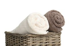 Rolled soft terry towels in wicker basket. On white background royalty free stock photos