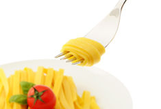 Rolled spaghetti on a fork Stock Images
