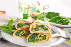 Rolled spinach pancakes as shashlik on sticks Royalty Free Stock Image