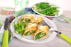 Rolled spinach pancakes cut into small pieces Royalty Free Stock Photo