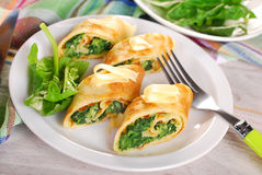 Rolled spinach pancakes cut into small pieces Stock Photos