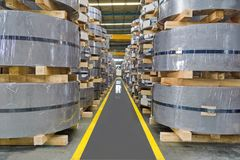 Rolled steel coil, Plate, Sheet, storage in coil center warehouse royalty free stock image