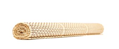 Rolled straw mat isolated Royalty Free Stock Photography