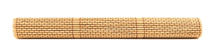 Rolled straw mat isolated Royalty Free Stock Photos