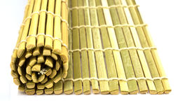 Rolled straw mat Stock Photo