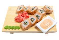 Rolled sushi on wooden stand Royalty Free Stock Images