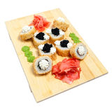 Rolled sushi on wooden stand Royalty Free Stock Photography