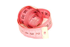 Rolled tailor measuring tape pink isolated on white Stock Photos