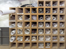 Rolled templates. Templates and patents arranged on a shelf in the factory upholstery stock image