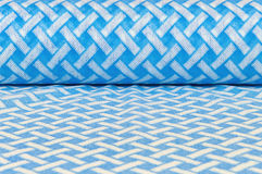 Rolled textile with blue and white pattern Royalty Free Stock Photography
