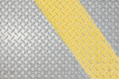 Rolled Textured Metal with Stripe. Rolled, Textured Metal with Yellow Stripe for Background royalty free stock photo