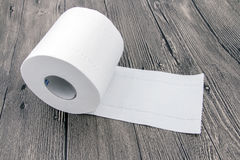 Rolled Toilet Paper. On wood background Stock Photography
