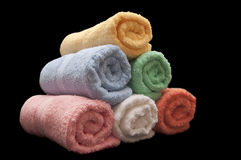 Rolled Towels. Colorful rolled towels isolated on black Stock Image