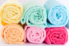 Rolled towels. Multi color of laden rolled towels on a white background Stock Photography