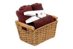 Rolled towels in a basket isolated Royalty Free Stock Images