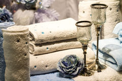 Rolled Towels, Blue Roses and Candle Holders Royalty Free Stock Images