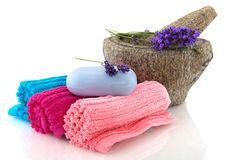 Rolled towels with lavender soap Stock Photo