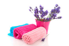 Rolled towels with lavender sprigs Stock Image
