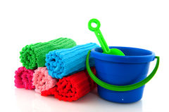 Rolled towels and playset Royalty Free Stock Image