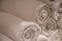 Rolled towels in a stack stock images