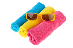 Rolled towels with sunglasses Stock Photos