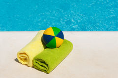 Rolled towels and toys Royalty Free Stock Photography