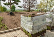 Rolled turf is laid on a company site royalty free stock image