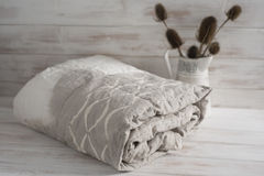 Rolled Two-Tone White and Gray Duvet with Thistle Plants Royalty Free Stock Photo