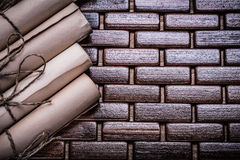 Rolled up ancient documents on wicker wooden Royalty Free Stock Photo