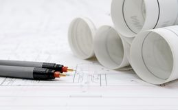 Rolled-up architectural plans and drawing tools. Rolled-up architectural plans and drawing utensils royalty free stock photography