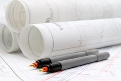 Rolled-up architectural plans and drawing tools. Rolled-up architectural plans and drawing utensils stock photos