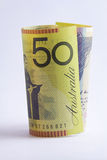 Rolled up Australian 50 dollar note. Isolated on white