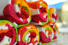 Rolled Up Beach Towels. Multi-colored beach towels rolled up ready to use at the pool or beach Stock Photo