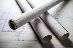 Blueprints. Rolled up blueprints on a drafting table Stock Photo