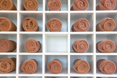 Rolled up brown spa towels Stock Photography