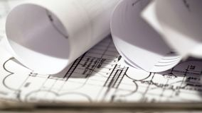 Rolled up building plan documents, architecture design, construction bureau. Stock photo royalty free stock photography