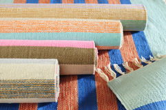 Rolled up carpet. Rolled up handmade carpet with stripes Stock Photos