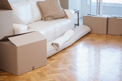 Rolled up carpet and boxes Royalty Free Stock Photos