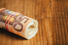 Rolled up cash money, euro banknotes Stock Photos