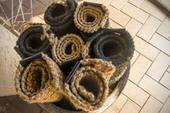 Rolled up Coconut Floor mats Royalty Free Stock Images
