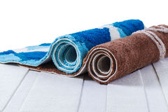Rolled up of colorful carpets. On white carpet Stock Photo