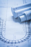 Rolled up construction plans building and Royalty Free Stock Images