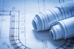 Rolled up construction sketches building concept Stock Photos