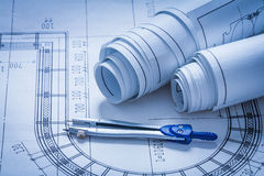 Rolled up construction sketches and drawing Royalty Free Stock Images
