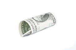 Rolled up dollar on white background. Detail of rolled up dollar on white background Royalty Free Stock Photography