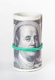 Rolled up dollars Stock Photos