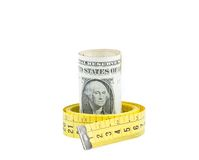 Rolled up dollars inside measure tape on white background, concept for business and save money Royalty Free Stock Images